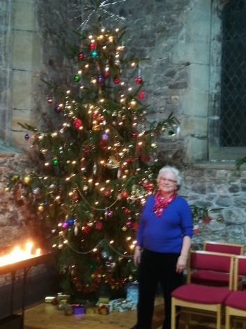 Christmas tree with Lilian Newby, Head Verger.
